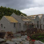 Dwelling takes shape as the roof goes on!