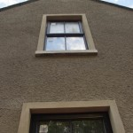 Detail of render and triple glazed windows. New house in Northern Ireland